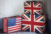 British and usa flag painted on carton box — Stock Photo
