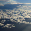 Kind on clouds on a background a firmament from an airplane  — Stock Photo