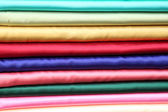 Colorful fabrics in a row — Stock Photo