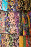 Shawls (scarfs) at the market — Stock Photo