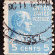 Old used postage stamp issued in honor of the fifth President of the United States James Monroe with his portrait on blue background series, circa 1938 — Stock Photo