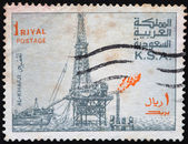 SAUDI ARABIA - CIRCA 1977: Postage stamps printed in The Kingdom of Saudi Arabia (KSA), shows the oil derrick in Al Khafji, circa 1977 — Stock Photo