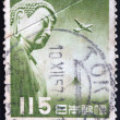 JAPAN - CIRCA 1953: A stamp printed in Japan shows Great Buddha of Kamakura and airplane flying over Fuji, circa 1953 — Stock Photo