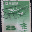 JAPAN - CIRCA 1959: A stamp printed in Japan shows plane above pagoda in temple Horyu-ji, circa 1959  — Stockfoto