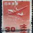 JAPAN - CIRCA 1959: A stamp printed in Japan shows plane above pagoda in temple Horyu-ji, circa 1959  — 图库照片