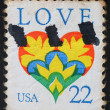 UNITED STATES OF AMERICA - CIRCA 1984: A stamp printed in the USA shows the word love and a love heart, circa 1984  — Foto Stock