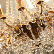 Beautiful crystal chandelier in a room — Stock Photo
