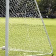 A shot of a soccer goal at the end of a empty field at a park — Foto Stock