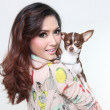 Fashionable happy woman with cute chihuahua in hand — Stock Photo