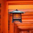 Chinese lantern in orange torii gates of Fushimi Inari Taisha Shrine — Stock Photo