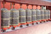 Bronze prayer wheels — Stock Photo