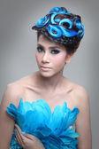 Elegant fashion brunette Thai woman posing with creative chignon hair-style — Stock Photo