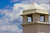 Chimney with cloudly sky — Stock Photo