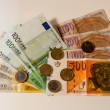Denars and euros on a table — Stock Photo