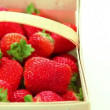Basket of red ripe delicious strawberries on white background — Stock Video #32581183