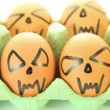 Scary vampire crazy eggs for halloween on white background — Stockvideo
