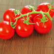 Beautiful ripe cherry tomatoes on bamboo background — Stock Video