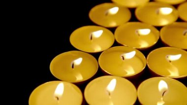 Candles background, prayer tea light candles, dolly-shot — Vídeo de Stock