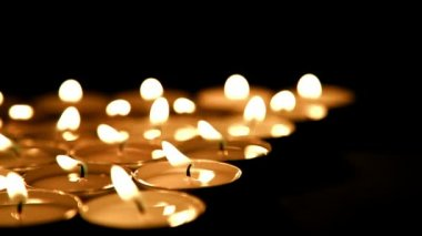 Candles background, prayer tea light candles, dolly-shot — 图库视频影像