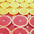 Stock Video: Sliced grapefruit with orange