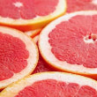 Stock Video: Red grapefruit fruits background