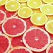 Stock Video: Sliced grapefruit with orange, motion background