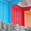 Colourful wooden beach huts — Stock Photo #29430351