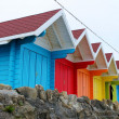 Colourful wooden beach huts — Stock Photo