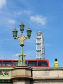 London symbols, London eye, Red bus, policeman and Westminster bridge — Stock Photo