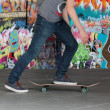 Teenager skater boy and skateboard — Stock Photo