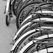 Row of bicycles in cycle bike rack — Stock Photo