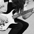 Teenager performer playing an electric guitar — Stock Photo #29797133