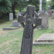 Celtic cross in graveyard — Stock Photo