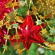 Christmas decorations for tree in gold glitter and red — Stock Photo #35615009