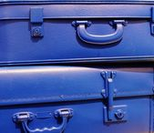 Blue stacked vintage style suitcases — Stock Photo