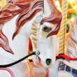 Vintage carousel merry-go-round painted horses - Stock Photo — Stock Photo #37238771