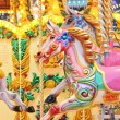 Vintage carousel merry-go-round painted horses - Stock Photo — Stock Photo #37238971