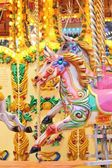 Vintage carousel merry-go-round painted horses - Stock Photo — Foto de Stock