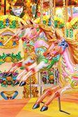 Vintage carousel merry-go-round painted horses - Stock Photo — Foto Stock