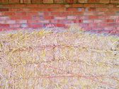 Straw hay bales with brickwall and copyspace — Stock Photo
