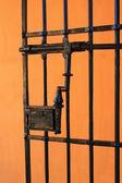 Orange wall with iron gate Spain — Foto Stock