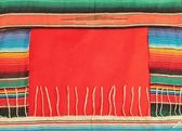 Mexico fiesta poncho rug in bright stripe background with copy space — Stock Photo