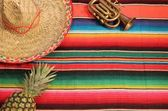 Mexico fiesta poncho rug in bright stripe background with copy space — Foto Stock