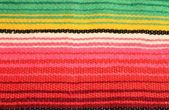 Mexico fiesta poncho rug in bright stripe background with copy space — Photo