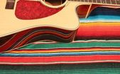 Mexico fiesta poncho rug in bright stripe background with copy space — 图库照片