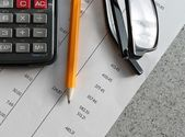 Bank statement with pencil and calculator — Stock Photo