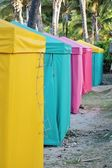 Row of colourful tents on the beach for shade — Stock Photo