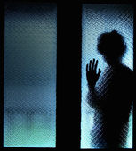 Silhouette of scared boy — Stock Photo