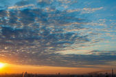 Morning cloudscape in city — Stock Photo
