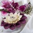 Stock Photo: Flower and wedding rings